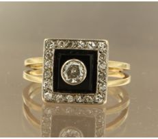 18k bicolour gold ring set with onyx and bolshevik and single cut diamonds, approx. 0.40 carat in total ****NO RESERVE PRICE****