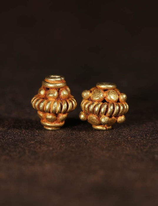 A Pair of Western Asian Gold Beads - 5.2 x 6.2mm; 5.2 x 5.4mm (2)