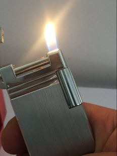 S.T. lighter.  DuPont Urban brushed Palladium