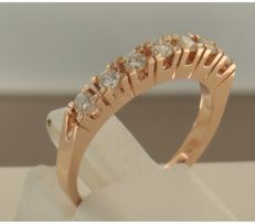 14 kt rose gold channel ring set with 7 brilliant cut diamonds of approx. 0.35 ct in total, ring size 17 (53)