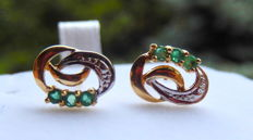 Earrings with emeralds and white sapphires in 18 kt yellow gold