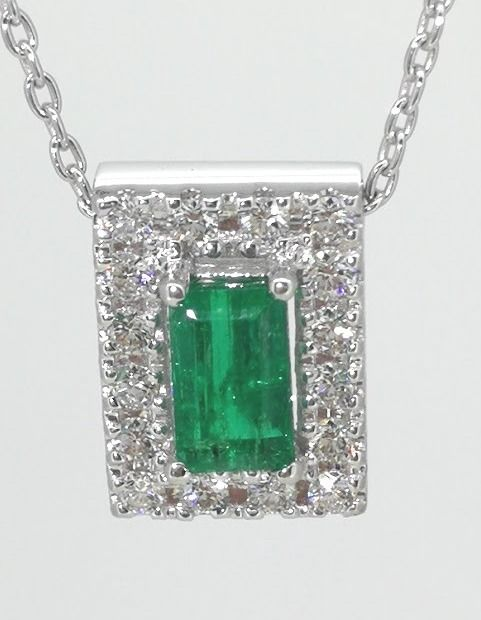 Pendant with a  natural 0.30  ct columbian  cut  green emerald  and 16 diamonds