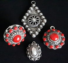 Four 'Zeeland buttons'; set (pendant and ring) and two pendants.