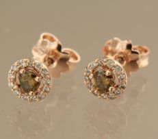 14 kt bi-coloured gold ear studs set with 28 brilliant cut diamonds, approx. 0.54 ct in total, diameter size 6.9 mm wide