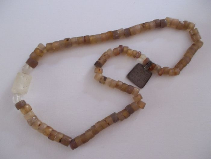 Necklace with Neolithic stones, quartz, jasper, more recent medallion, length when unfolded: 60 cm, weight: 126 g.