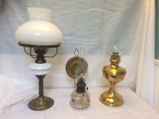 Three oil lamps, of which one was made electrically - circa 1920 and later