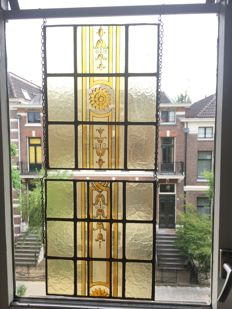 Two gorgeous old Jugendstil handmade stained glass windows (suncatchers) of oxide silver with soft colours from around 1920.