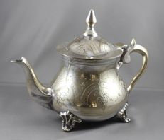 Silver plated teapot with floral decor