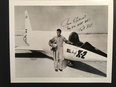 "Original signed Photo by Brigadier General Frank Kendall ""Pete"" Everest, Jr. US Test Pilot shwoing him in front of its Bell X-2 plane"