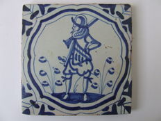 Accolade tile with a Spanish soldier