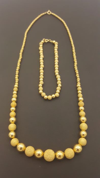 Set of necklace and gold bracelet – 18 kt – 12.7 g – 45 cm + 18.5 cm.