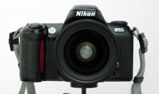 Nikon F65 with AF Nikkor 28-80mm, F1:3.5~5.6 and lens cap.