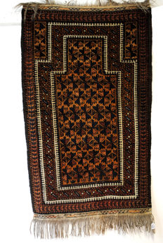 Hand-knotted prayer rug of the Belouch nomads, east Iran/west Turkmenistan