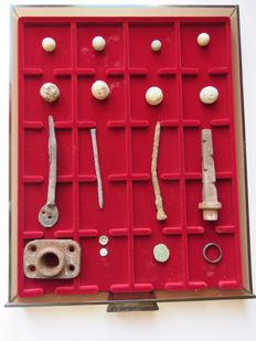 Archaeological finds from the battlefield of Waterloo in display case tray