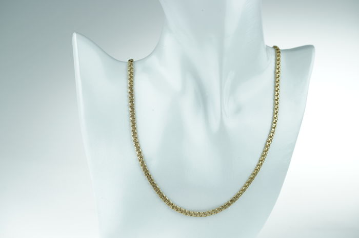 14 kt Gold women's fantasy necklace, robust execution, new condition. Length: 53 cm.