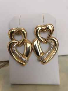 18 KT yellow gold designer ear studs with in total approx. 0.16 ct of brilliant cut diamonds H/VS/SI