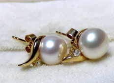 Cultured freshwater button pearl earrings with diamonds