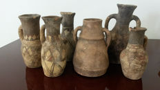 Six terracotta vases from Southern Europe, likely of Spanish origin with Arabic influences
