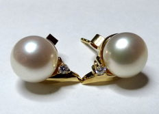 Cultured freshwater button pearl earrings with 0.10 ct diamonds