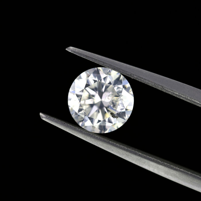 1.52 Ct. Natural G Color Round brilliant cut diamond. I1