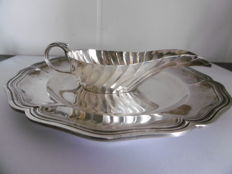 Sauceboat with tray, from silversmith F. DUCOT of Bordeaux, minerva's head hallmark and mark of master silversmith Jules Monney (1884-1895).