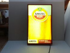 Old illuminated advertising Amstel beer - France - 1985.