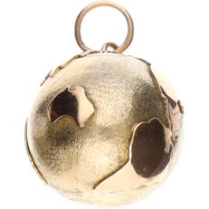8 kt yellow gold pendant in the shape of a globe Length: 2.5 cm