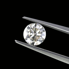 0.91 Ct. Natural E Color Round brilliant cut diamond. No Reserve Price.