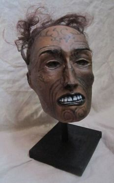 Interesting replica of a Maori mummifed Head, on customised stand - 28cm