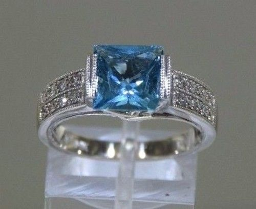 14 kt white solid gold ring with 0.32 ct diamond and blue topaz - Size: 55.