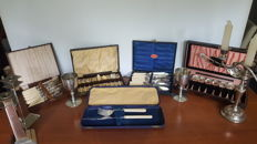 Five cased sets of silver plated flatware