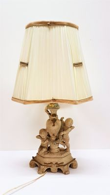 Table lamp with cherubs and fabric lamp shade