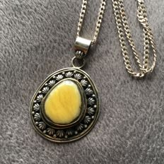 Old silver egg yolk Baltic Amber pendant, on silver chain