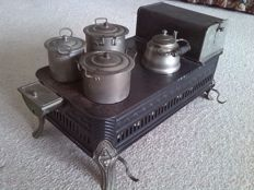 Children's furnace black metal with 3 pans and kettle from ± 1932