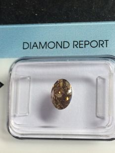 Orangy brown diamond in oval cut clarity P1, 0.69 ct