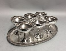 Six silver plated champagne coupes on a oblong serving tray with floral decoration, ca 1950