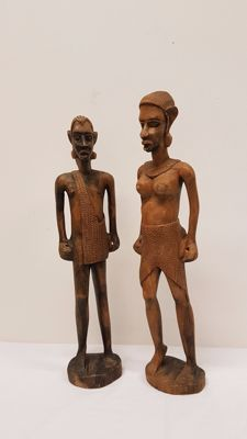 Two wooden sculptures of an African man / woman