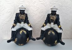 Two blackamoors seated on a ball, the Netherlands, 2nd half of the 20th century
