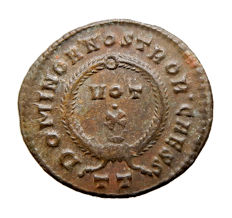 Roman Empire - Crispus (316-326 A.D.) bronze follis (2,96 g. 19 mm). 322-325 A.D. VOT X Crescent. DOMINOR NOSTROR CAESS. TT.