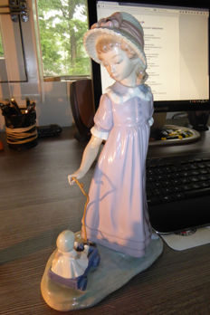 Lladro girl with play cart