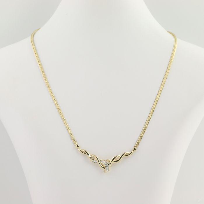 14 kt / 585/1000 yellow gold necklace set with VS - F diamonds - Length of 42.6 cm x 2.80 mm.