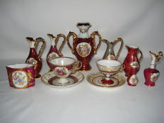 Limoges: Collection of 6 porcelain pieces, 1 flower vase, 3 water jugs, 1 spoon vase, 1 miniature vase and 2 cups and saucers.