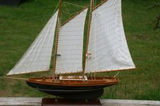 Large decorative wooden sailing boat of 85 cm long.