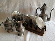 Lot of 10 matching tin pieces: Coffee pot, milk jug, sugar bowl, 6 saucers and 1 dish with dish base, sealed.