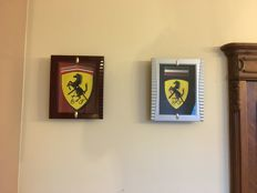 Set. Two FERRARI clocks. FERRARI Logo. FERRARI Advertisement. Unused.
