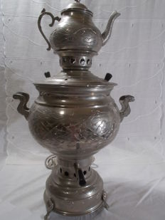 An electric Russian Samovar made of copper alloy, with a teapot