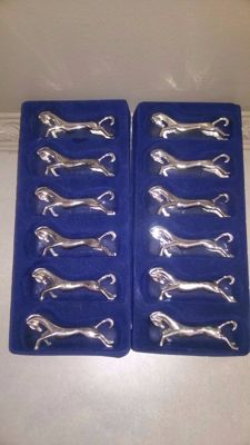 12 beautiful knife holders, silver-plated, horse-shaped.