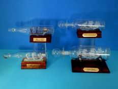 Collection of 4 glass ships in glass