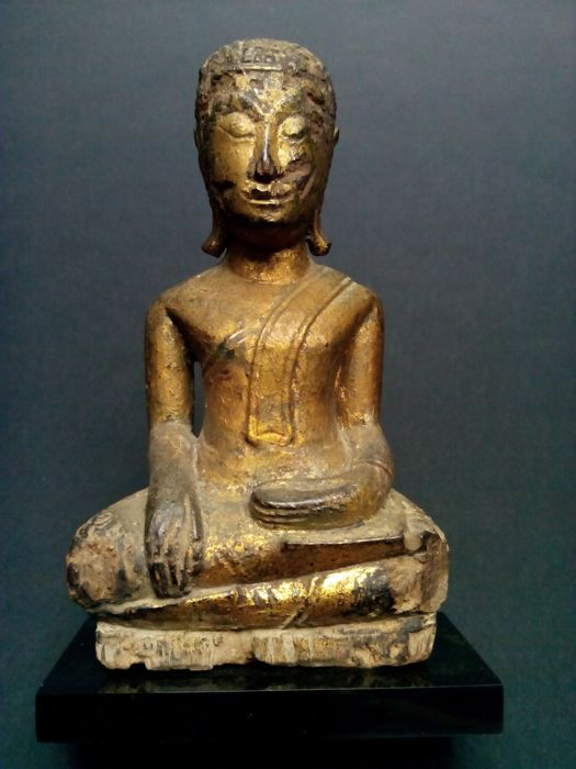 A gilt-wood figure of Buddha Shakyamuni. Kingdom of Ayuttahya - Thailand - 18th century