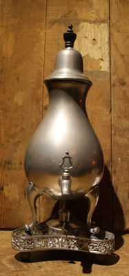 Large tin jug with a spout with burner and trivet